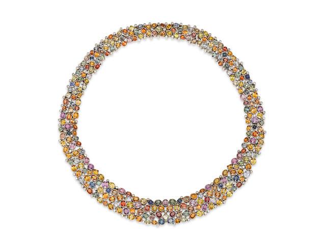 A multi-colored sapphire, diamond, silver-topped gold collar