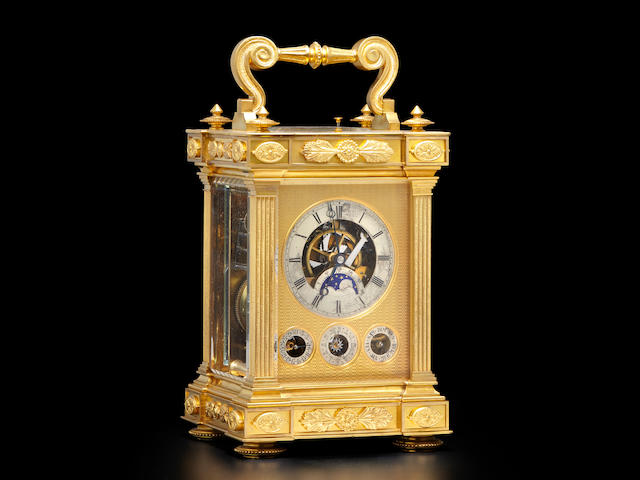 A fine and rare gilt minute repeating Grande Sonnerie carriage clock with perpetual calendar, moon phase and alarm Signed on the front plate, Le Frand A Paris, last quarter 19th century
