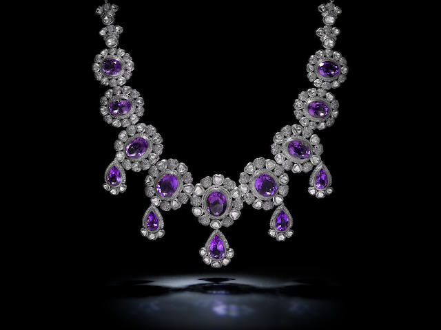 An amethyst, diamond and silver necklace and earring set