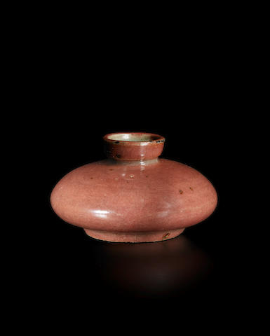 A small celadon copper-red glazed cosmetic stoneware jar Goryeo dynasty (918-1392), 12th century
