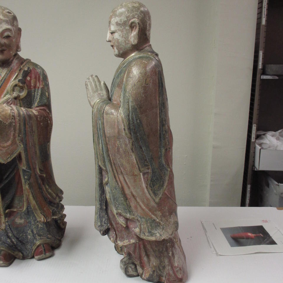 A Pair of polychrome lacquered wood figures of Kasyapa and Ananda  Qing dynasty