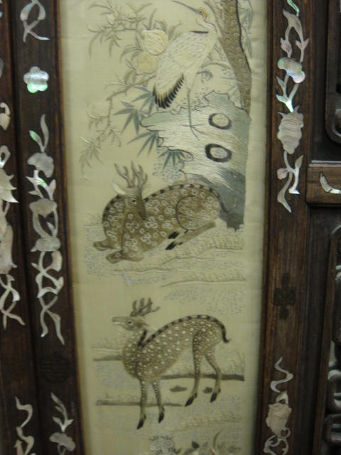A hardwood screen mounted with Guangdong embroidery silk panels  Late Qing/Republic period