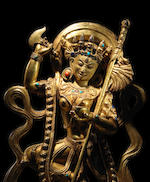 A GILT COPPER ALLOY FIGURE OF VAJRAVARAHI DENSATIL, 14TH CENTURY