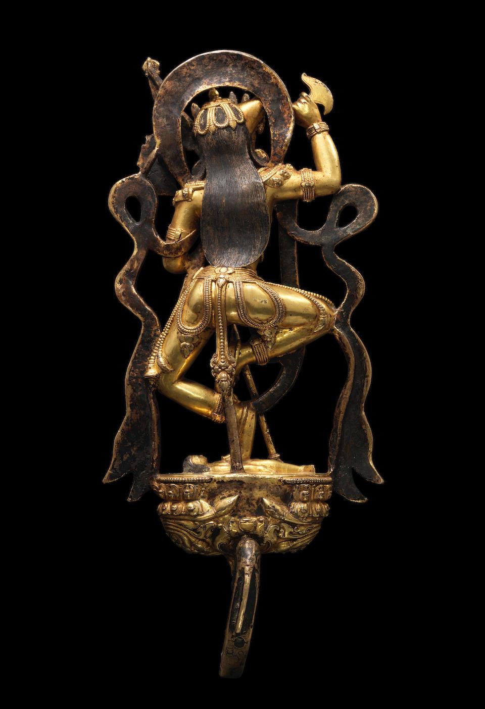 A GILT COPPER ALLOY FIGURE OF VAJRAVARAHI DENSATIL, 14TH CENTURY