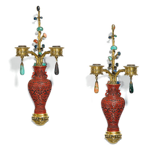 A pair of paint decorated and hardstone set gilt bronze two light bras de lumière attributed to E.F. Caldwell & Co, New York Circa 1915