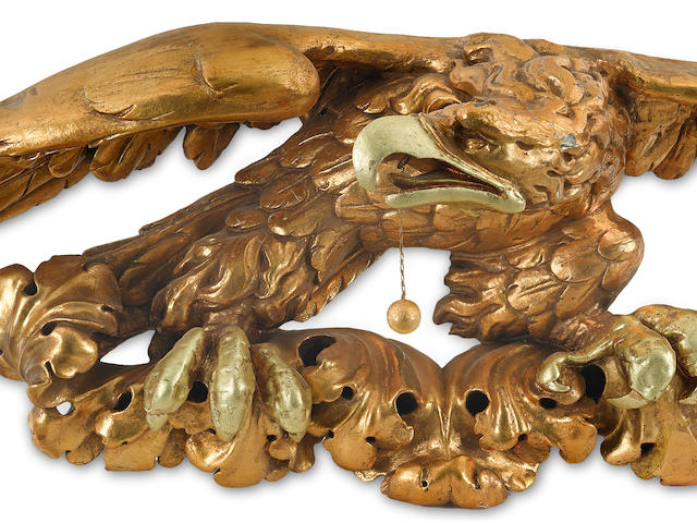 A carved and gilt eagle early 20th century 47-1/2 x 12-1/2 in., wingspan x height.