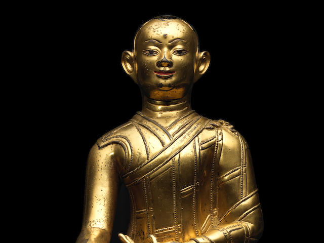 A GILT COPPER ALLOY FIGURE OF JIGTEN SUMGON RINCHEN PEL TIBET, 13TH CENTURY