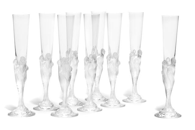 A set of nine champagne flutes: Flute Majestique After a design by Erté (Romain de Tirtoff) (1892 -1990)Late 20th century