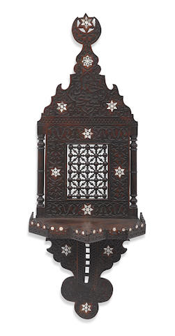 A Levantine shell inlaid and carved hardwood wall bracket circa 1900
