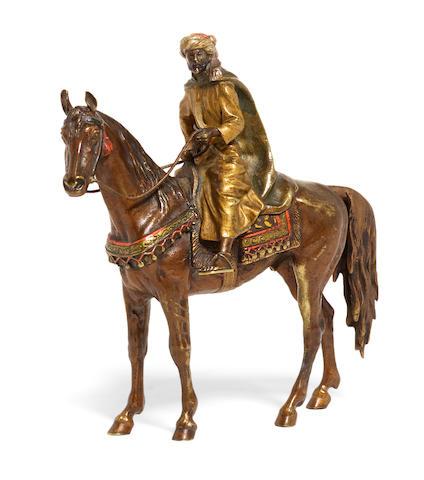 An Austrian cold painted bronze figure of a man on horseback