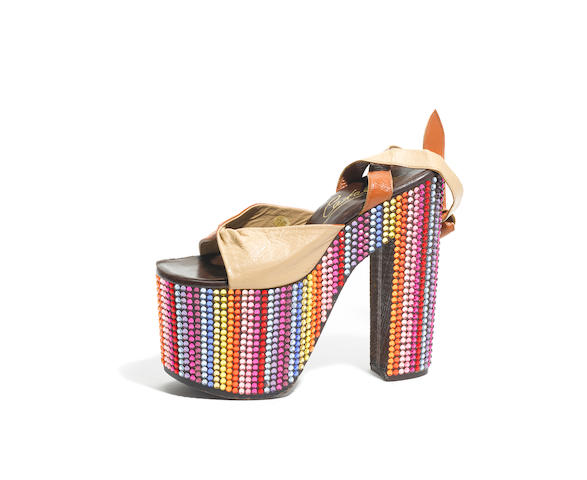 A single rainbow platform shoe worn by Cher