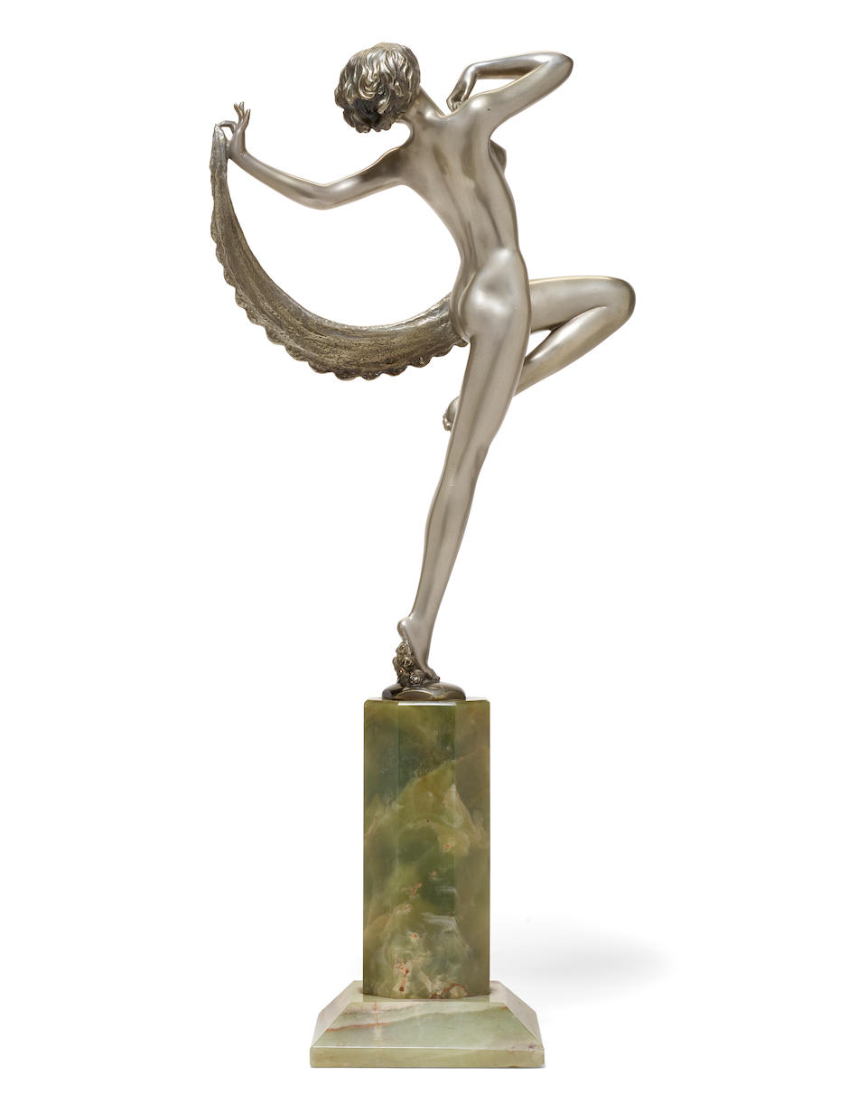 Josef Lorenzl (Austrian, 1892-1950) An Art Deco cold painted and silvered bronze and onyx figure of a Scarf Dancercirca 1925
