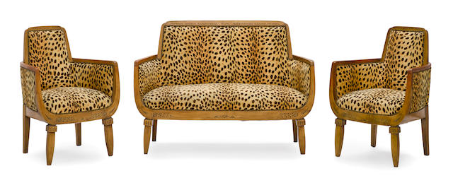A French Art Deco faux animal skin upholstered walnut three-piece salon suitecirca 1925, the upholstery later
