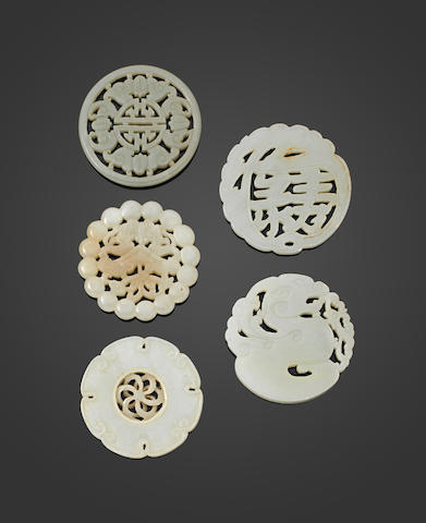 A group of five reticulated circular jade plaques Late Qing/Republic period