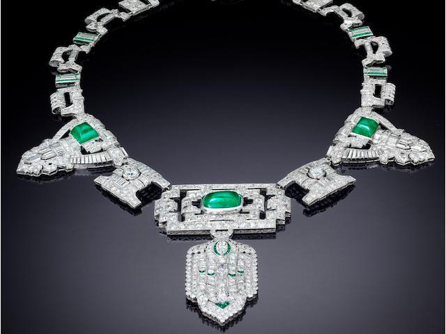 A diamond, emerald, stone and platinum necklace