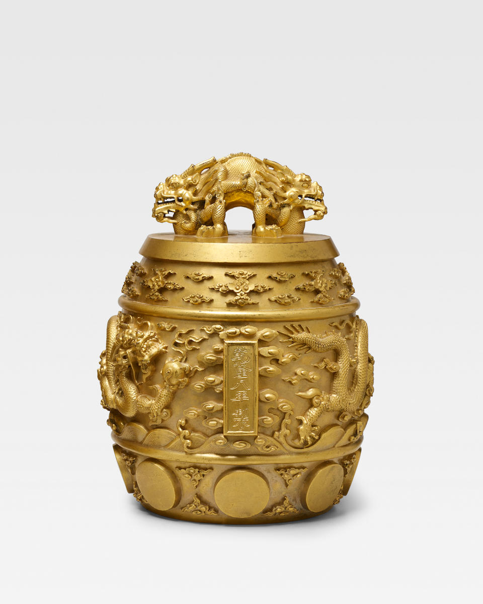 A RARE AND IMPORTANT IMPERIAL GILT-BRONZE RITUAL 'HUANGZHONG' BELL, BIANZHONG Qianlong mark and of the period, dated Qianlong 8th year, corresponding to 1743
