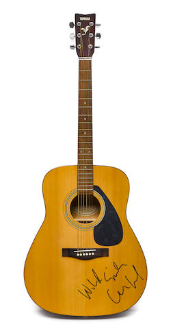 A Yamaha acoustic guitar signed by Lou Reed with lyrics