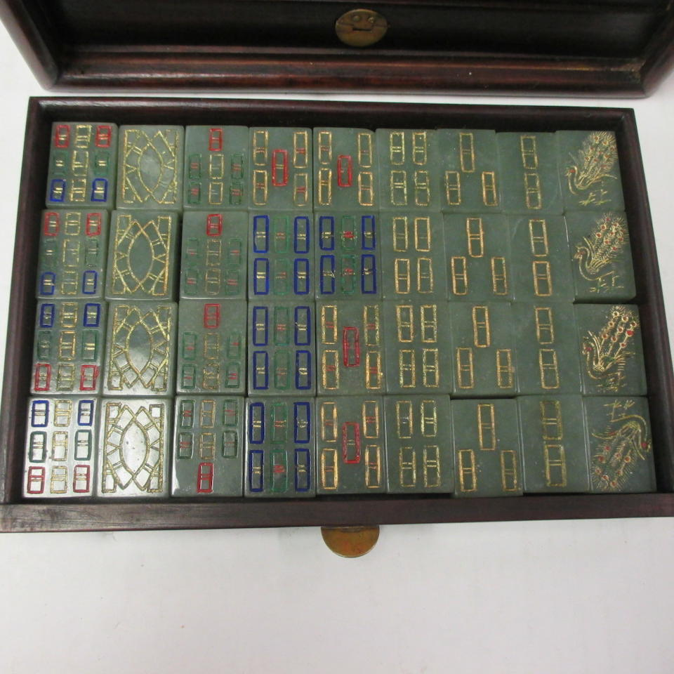 An unusual jade mah jong set in a wood storage case with applied jade plaque decoration Republic period
