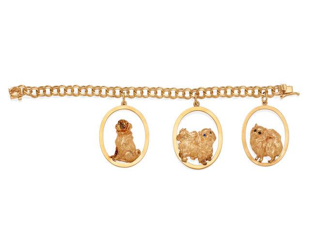 A 14k gold dog charm bracelet