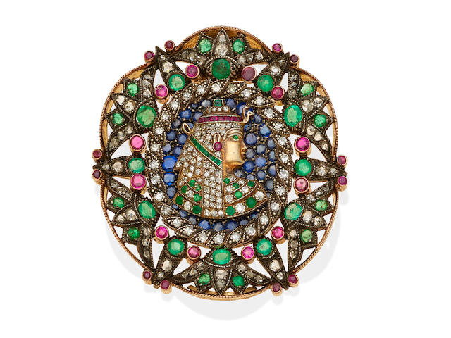 An Egyptian revival diamond, gem-set and silver-topped gold pendant