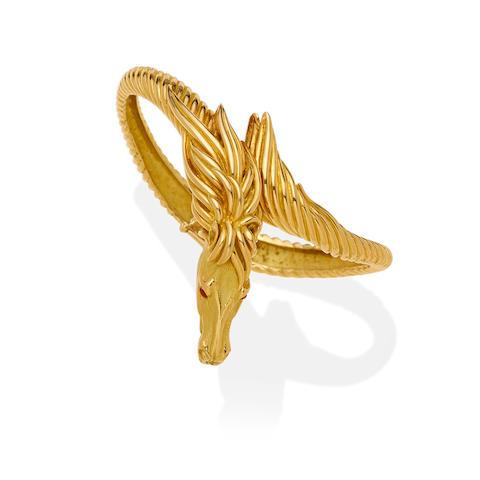 An 18k gold 'horse' bangle bracelet, French