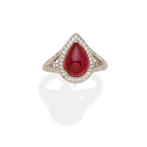 A ruby, diamond and 18k white gold ring/pendant