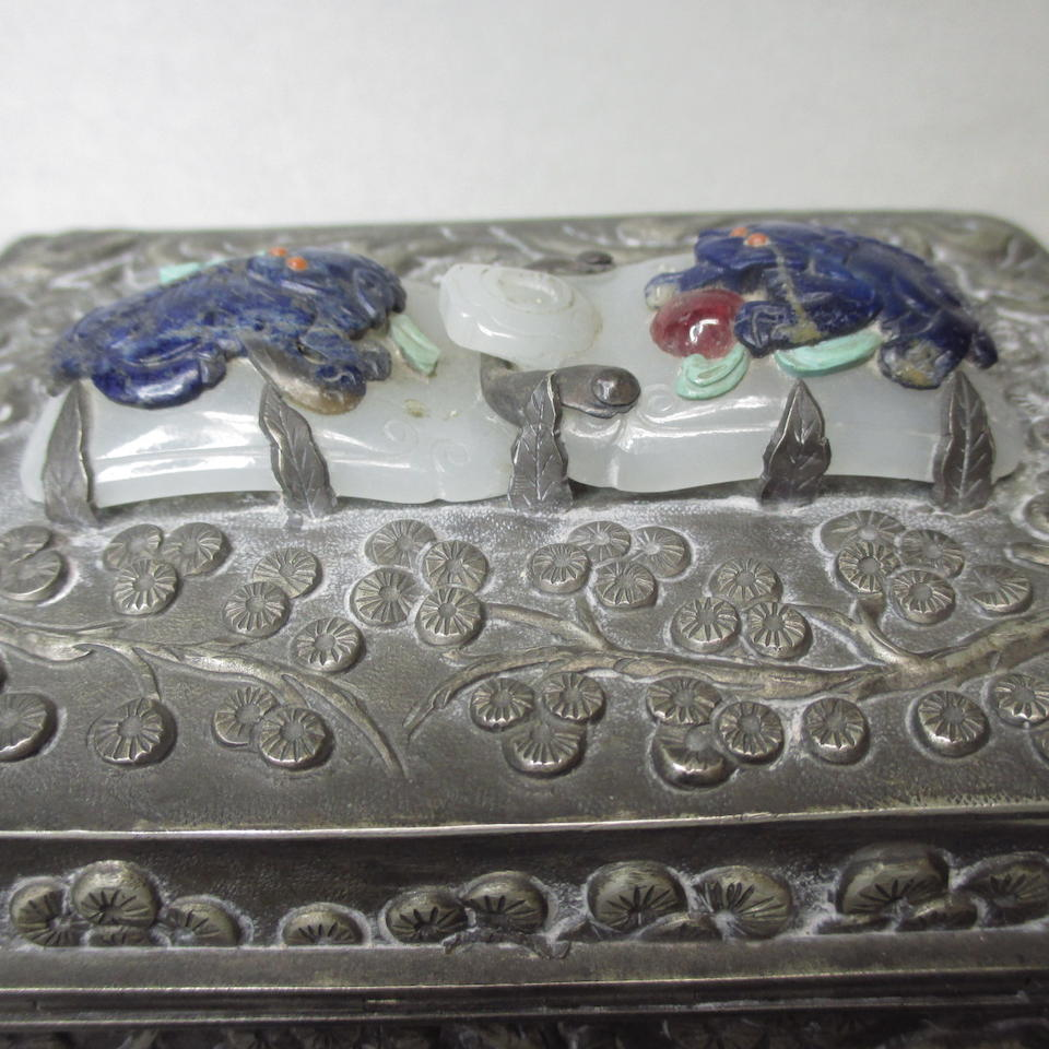 A white metal box mounted with a jade belt buckle  Late Qing/Republic period