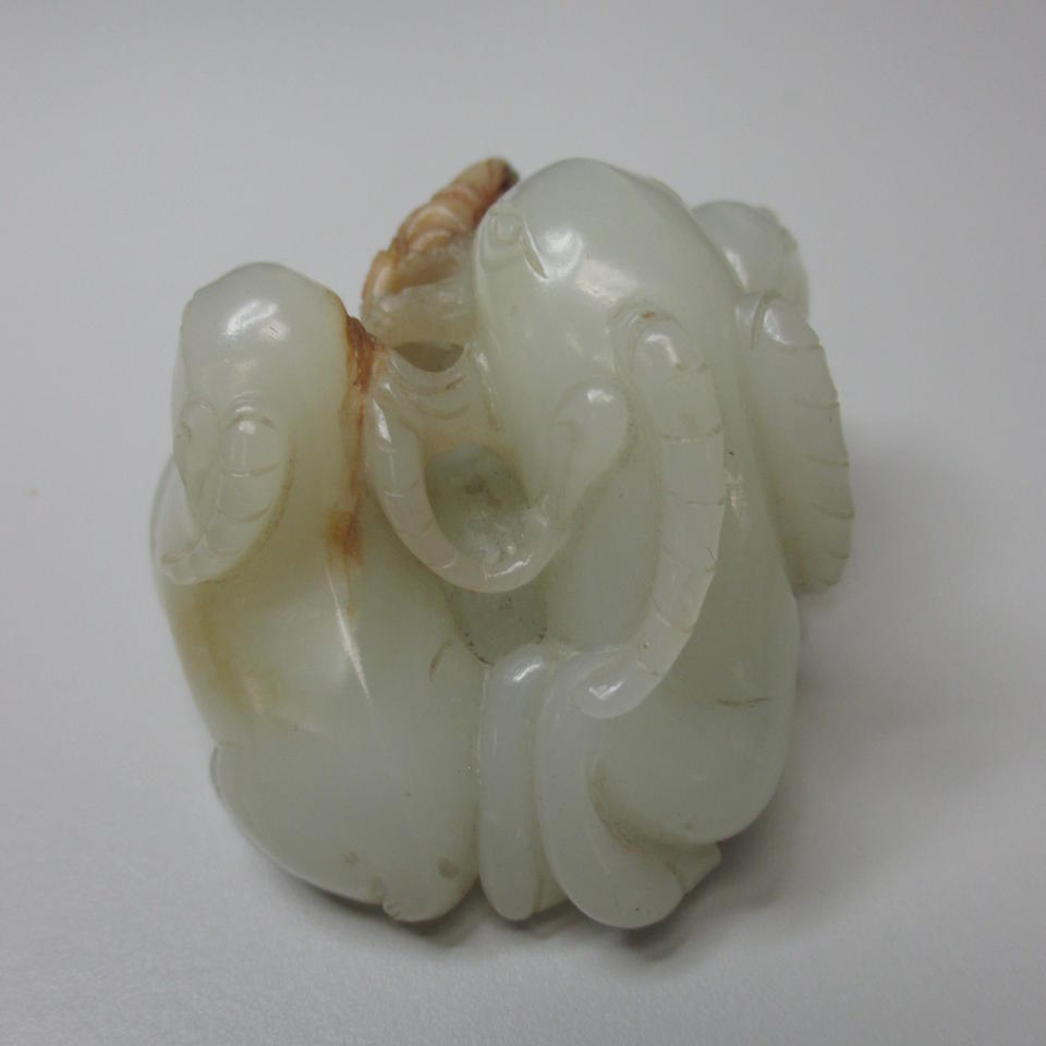 A carved jade  group of three rams and taiji symbol 18th/19th century