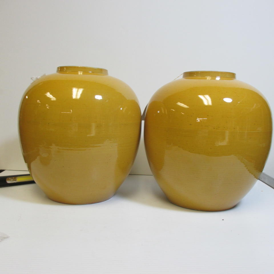 A pair of yellow glazed ginger jars and covers Late Qing/Republic period