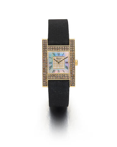 CHOPARD. A FINE 18K YELLOW GOLD AND DIAMOND LADY'S WRISTWATCH