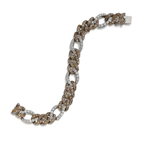 A diamond, colored diamond and 18K white gold bracelet