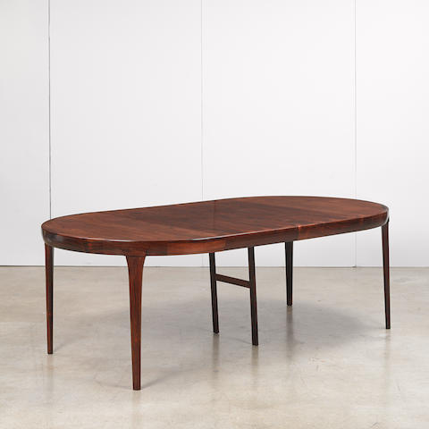 Ib Kofod-Larsen (1921-2003) Extending dining table for Faarup Møbelfabrik, rosewood, with  two leavesheight 28 1/2in (72.5cm); diameter 47in (119.5cm); length extended 87in (221cm)