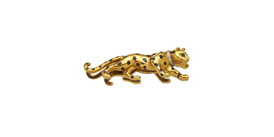 A diamond, emerald, enamel and 14K gold panther brooch