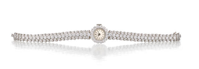 Patek Philippe. A fine platinum and diamond lady's bracelet watch Ref: 3289/34, sold June 13, 1966