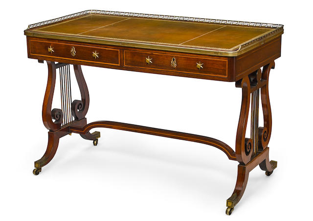 A good Regency gilt brass mounted goncalo alves writing table attributed to Gillows early 19th century