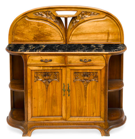 An Art Nouveau carved walnut and variegated black marble buffetcirca 1900