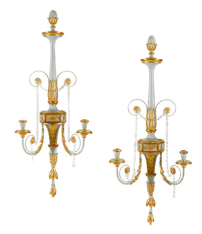 A pair of George III style parcel gilt and paint decorated carved wood and tôle two light wall sconces post 1950