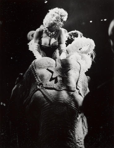 Weegee (Arthur Fellig) (1899-1968); Marilyn Riding a Pink Elephant, Opening Night of Ringling Brothers Circus, Madison Square Garden, New York City;