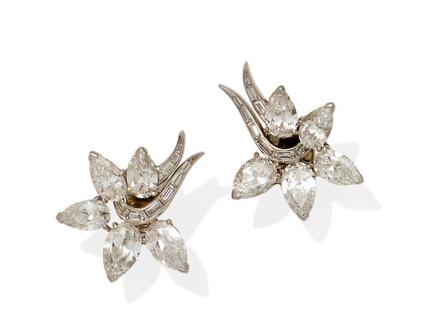 A pair of diamond and platinum ear clips