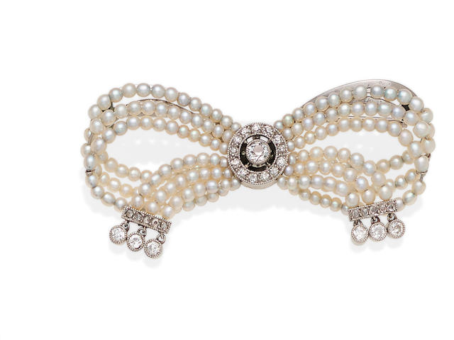 A Belle Époque seed pearl, diamond and platinum bow brooch, Cartier,