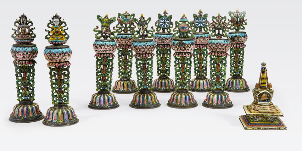 An assembled group  of polychrome enameled silver Buddhist altar ornaments and a stupa Late Qing/Republic period