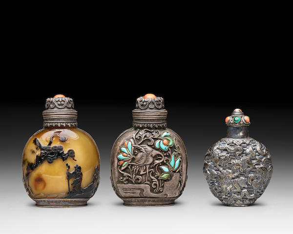 TWO SILVER REPOUSSE SNUFF BOTTLES 19th century