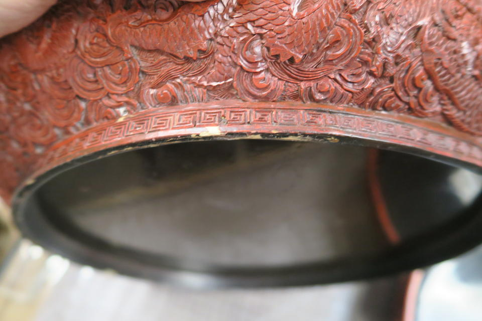A large carved cinnabar lacquer covered box with nine dragons decoration 18th/19th century