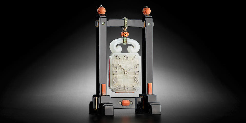 Cartier.  A very fine diamond-set jade, onyx, coral, beryl and gold Chinoiserie desk clockAttributed to Maurice Couet, Paris, movement signed by European Watch & Clock Co. Circa 1927
