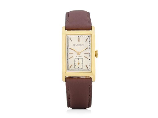 Patek Philippe. An extremely rare 18K gold eight-day manual wind rectangular wristwatch and a 14K gold braceletsold June 21st, 1932
