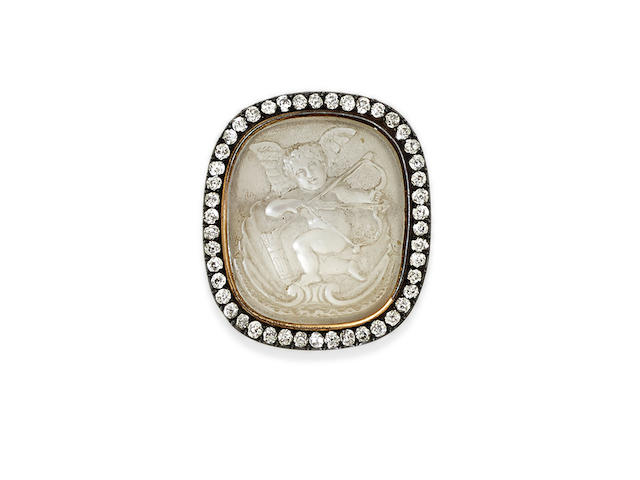 A carved moonstone, diamond and silver-topped gold brooch,