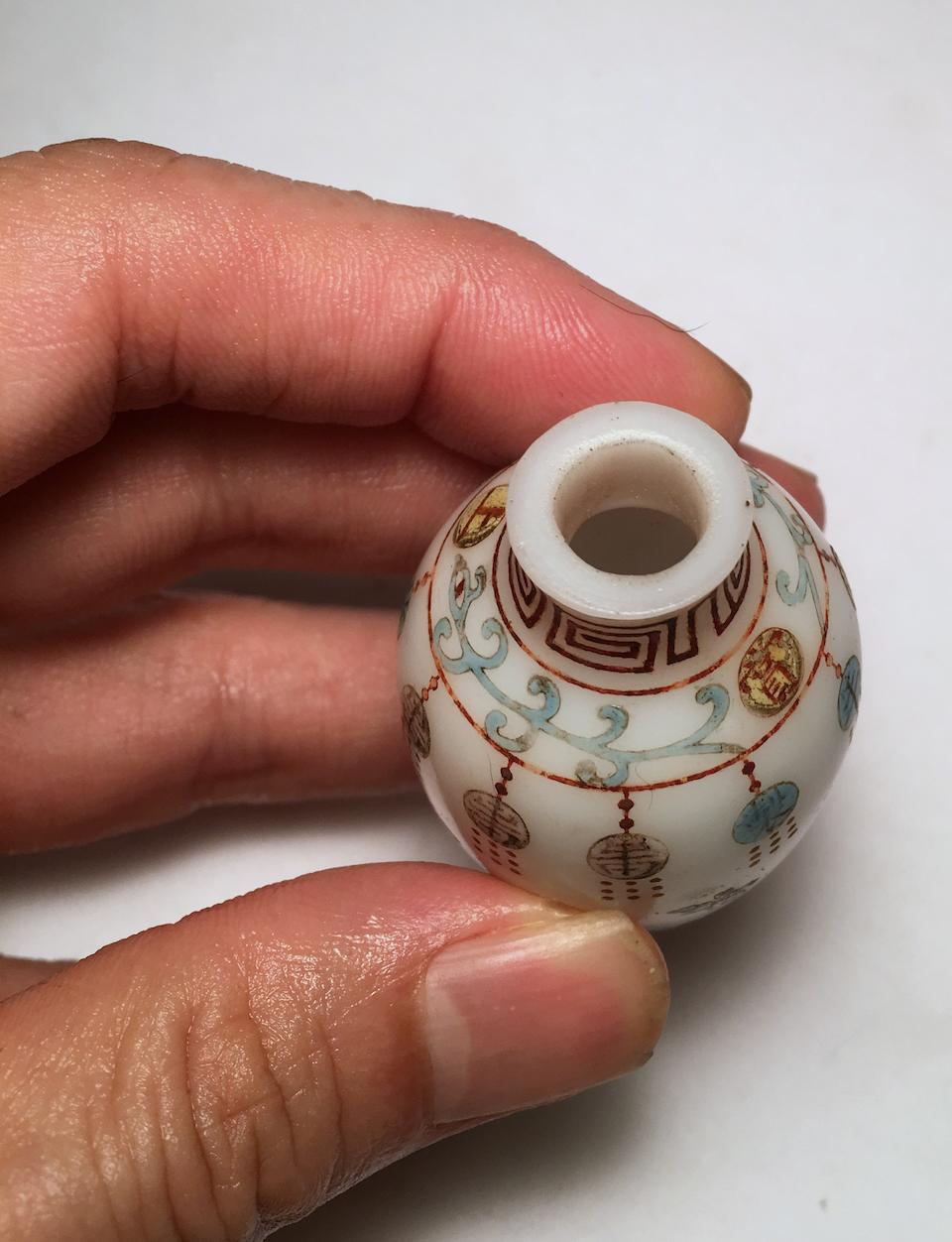 AN ENAMELED GLASS 'LOTUS' SNUFF BOTTLE Imperial, Qianlong mark and of the period