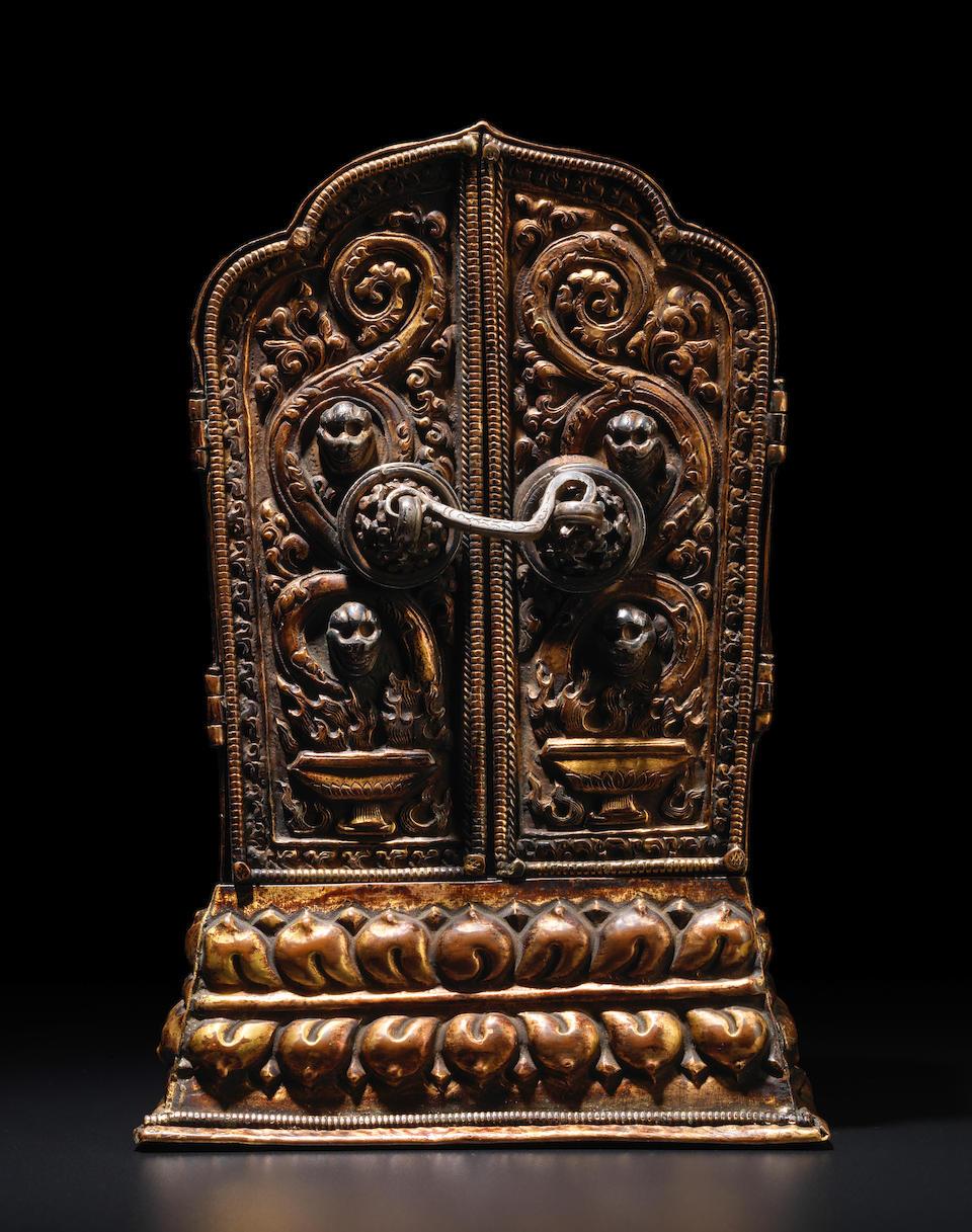 A GILT COPPER ALLOY REPOUSSÉ SHRINE WITH A GILT SILVER FIGURE OF VAJRAVARAHI TIBET, CIRCA 15TH CENTURY