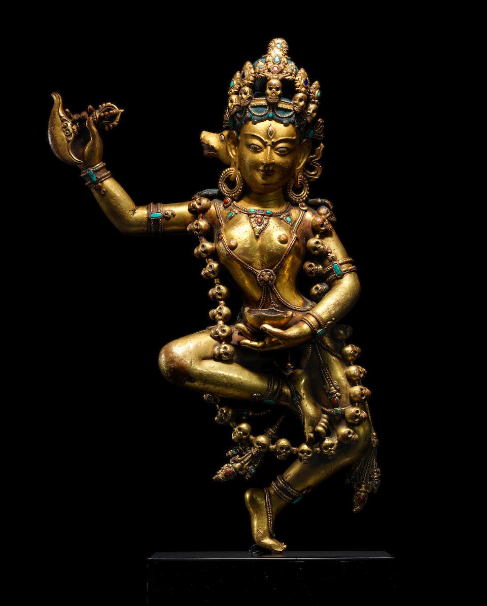 A GILT COPPER ALLOY FIGURE OF VAJRAVARAHI CENTRAL TIBET, CIRCA 14TH CENTURY