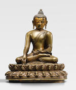 A SILVER AND COPPER INLAID BRASS ALLOY FIGURE OF SHAKYAMUNI BUDDHA TIBET, CIRCA 13TH CENTURY